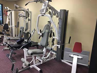 TuffStuff Odyssey 5 Gym With Leg Press USED