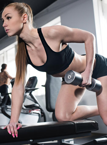 anti-aging woman with dumbbell