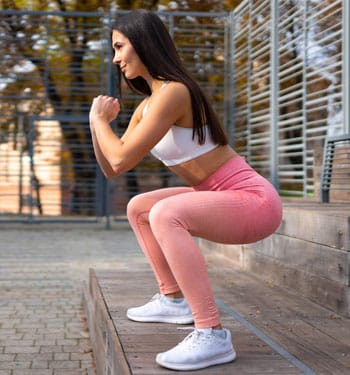 busy schedule workout woman doing squats