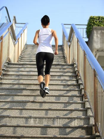 busy schedule workout woman running up stairs