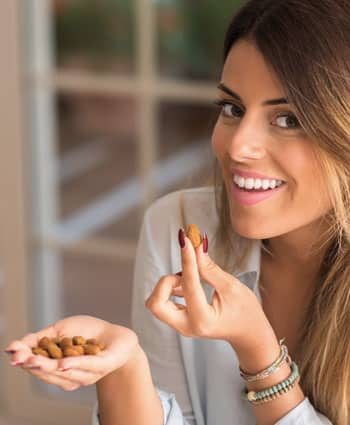 hunger cravings woman eating nuts