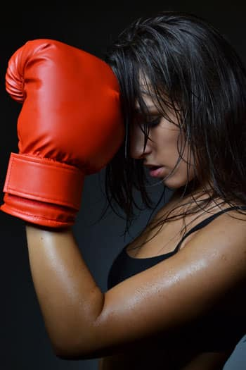 martial arts woman wearing boxing gloves
