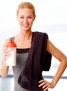 woman holding protein powder shake