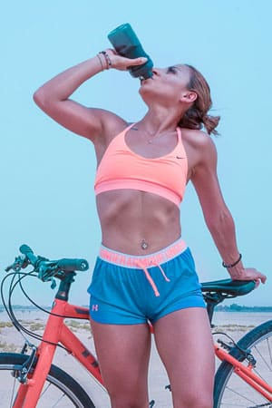 Woman with sports drinks