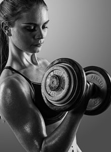 women lifting weights featured
