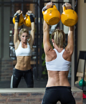 working out with kettlebells woman