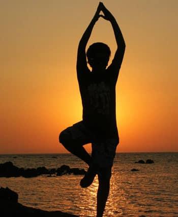 workout habit yoga on the beach